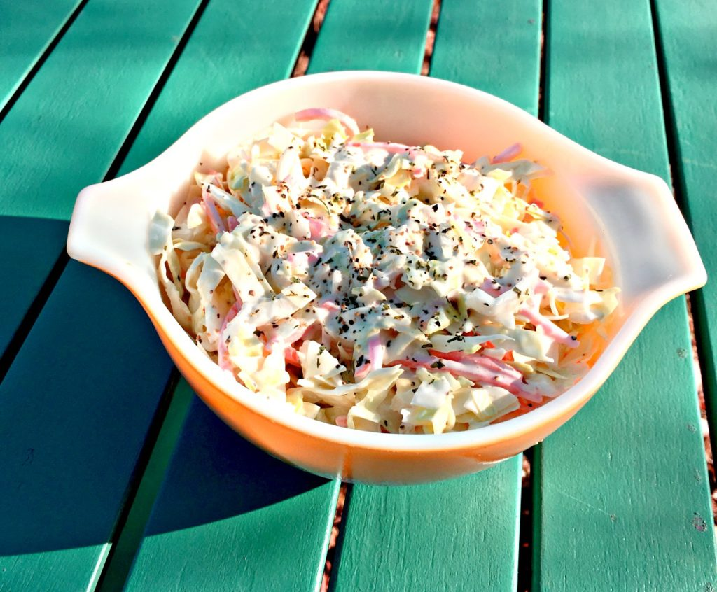 Cabbage Slaw or Cole Slaw is so easy to make and will make your the queen of the potluck or family dinner once you make this cold delicious dish.