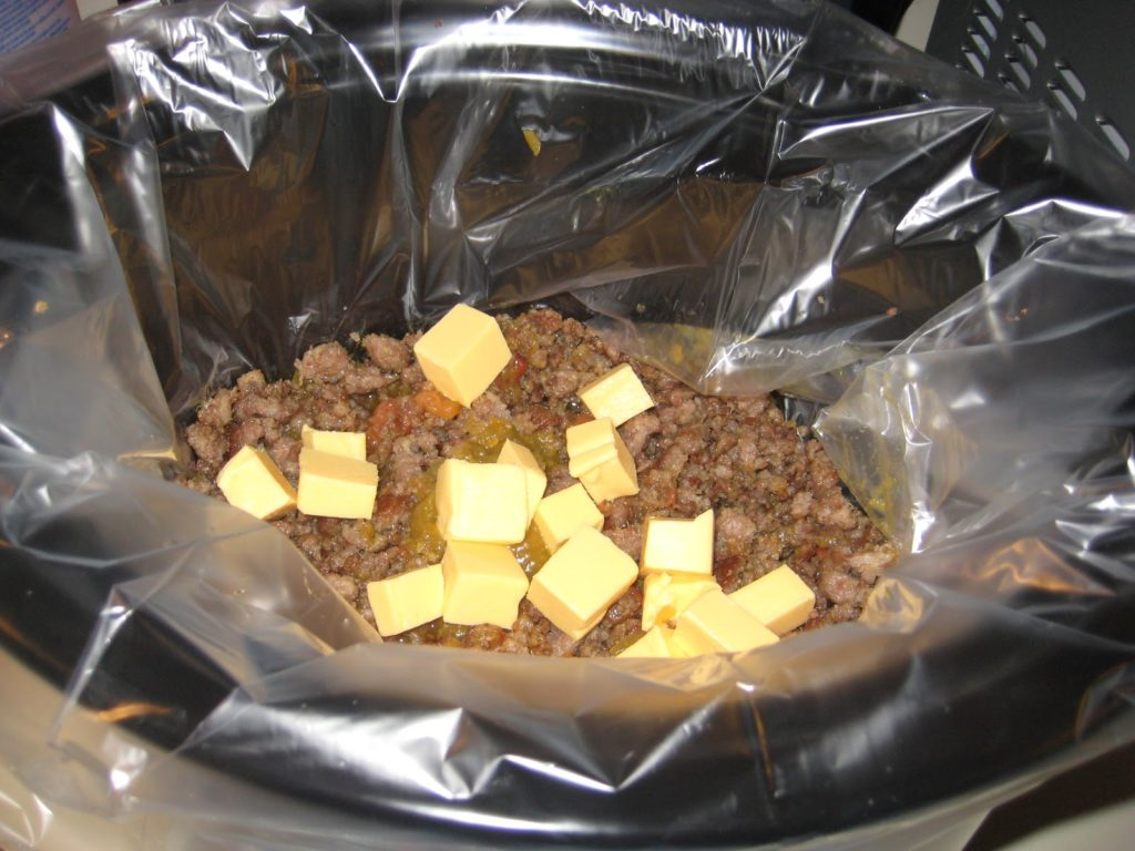 Crock Pot Italian Sausage Queso for New Year's Eve!